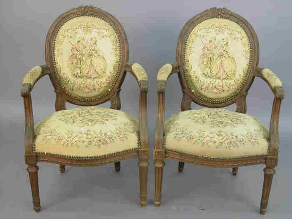 13: Pair Louis XVI style walnut arm chairs