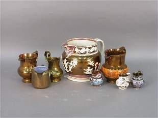 Eight pieces of Copper Lusterware.