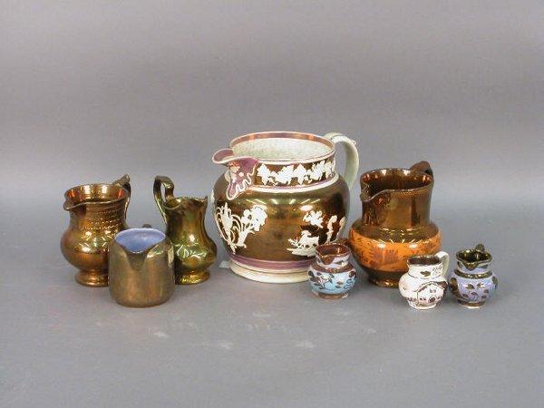 304: Eight pieces of  Copper Lusterware.