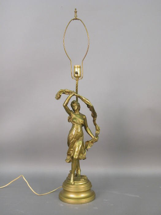 318: A gilt lamp with a figure of a dancing