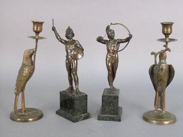 319: 4pcs. - A pair of bronze candlesticks