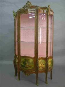 208: A Louis XV style vitrine with 6 legs,