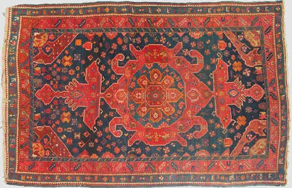 19: A Persian Kurdish rug with navy ground.