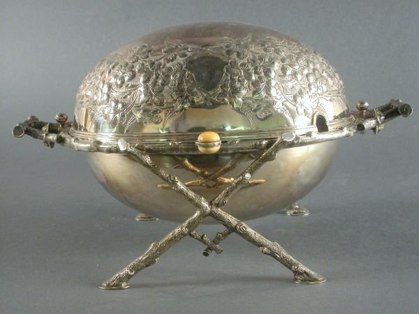 21: Silver plate revolving server with