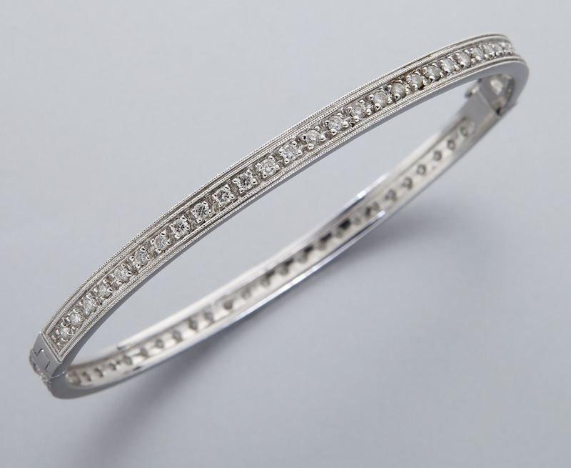 18K gold and diamond eternity bangle bracelet.