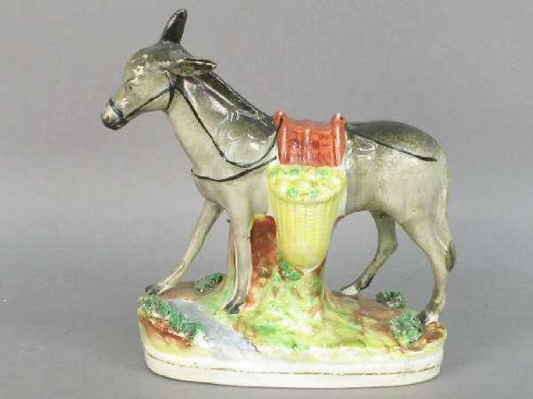 503: Staffordshire figure of a burro with yel