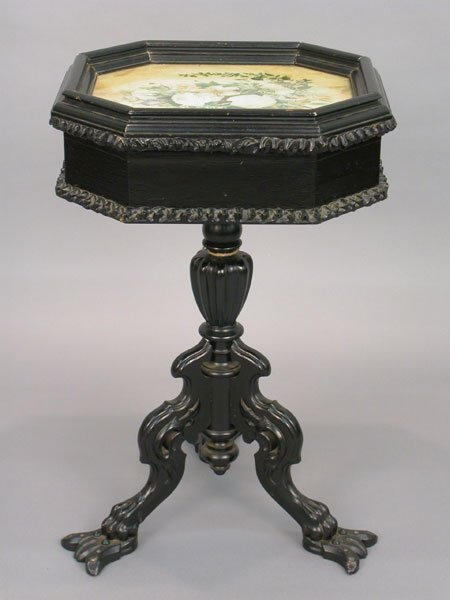 504: Intricately carved table on tripod legs