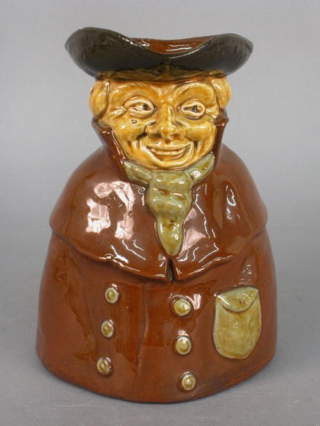 """507: Red ware Toby jug, 1/4"""" chip on rim - 8"""""""