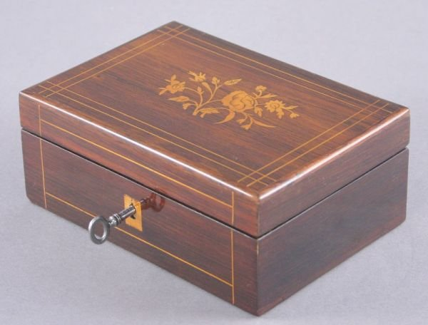 5: A French rosewood box with floral satinwood inlay