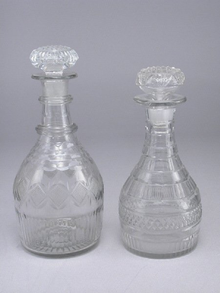 20: (2) Cut and pressed glass decanters, both