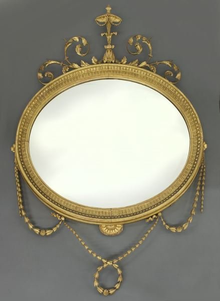 Oval Adams style gilt wood and gesso wall mirror,