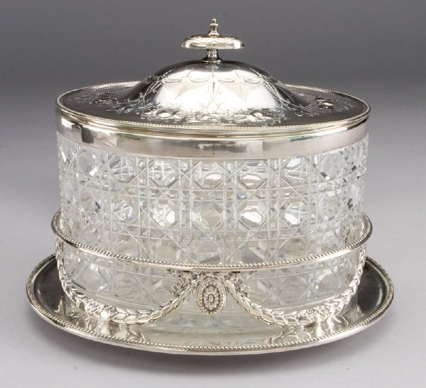 4: An oval cut glass and silver plate biscuit box