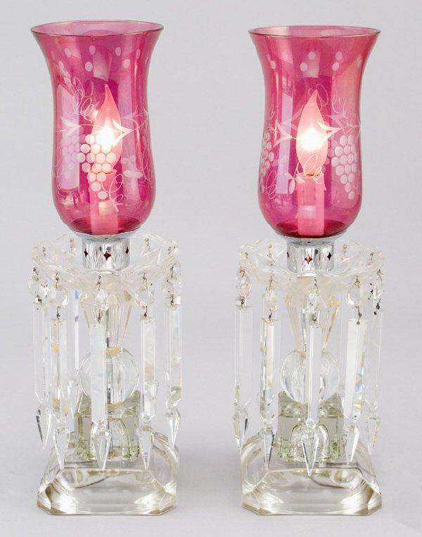 11: Pr. of crystal lustre lamps having cranberry