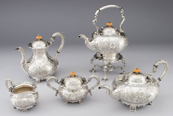15: A silver plate tea service including: