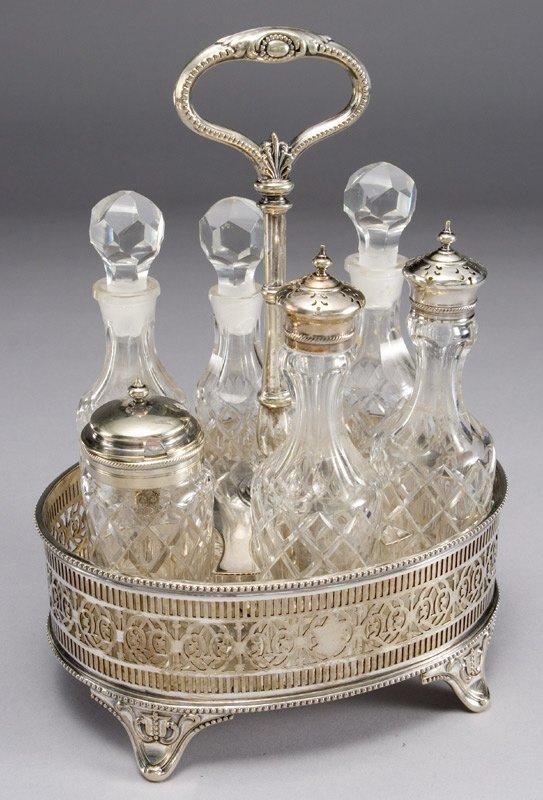 17: Glass and silver plated cruet set having six