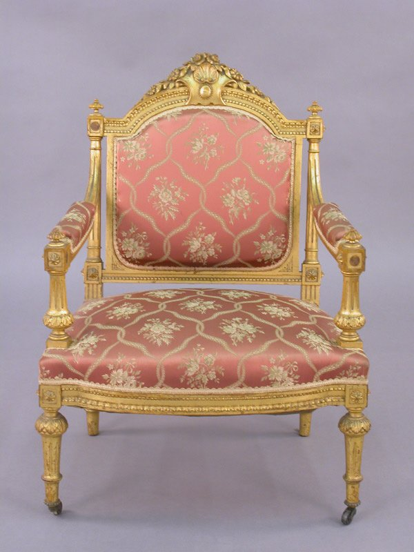 21: A French carved gilt wood armchair having shell