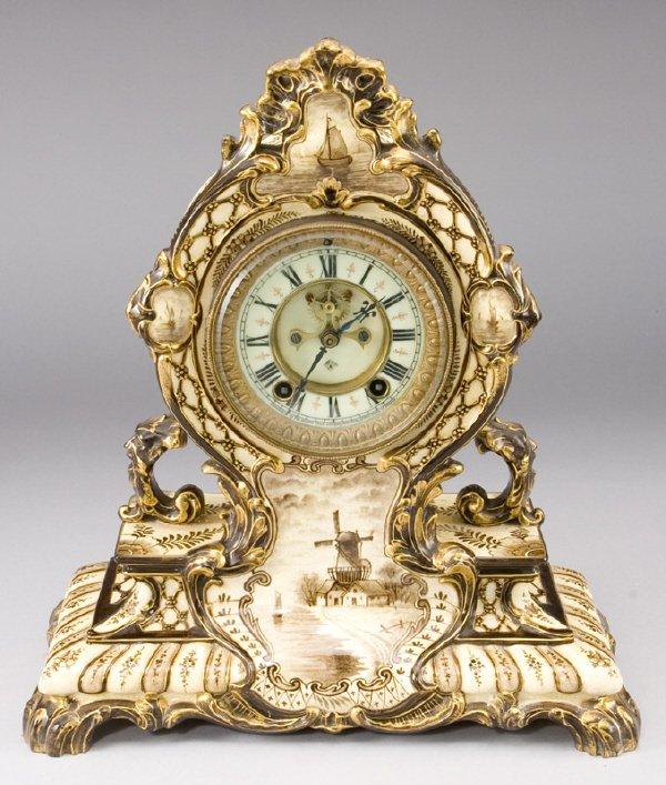 59: Ansonia mantel clock housed in a Royal Bonn