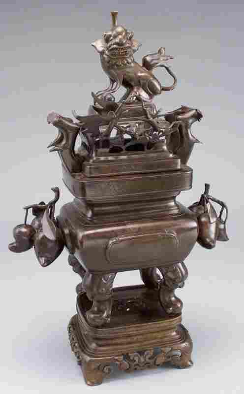106: A Japanese three piece bronze censor,