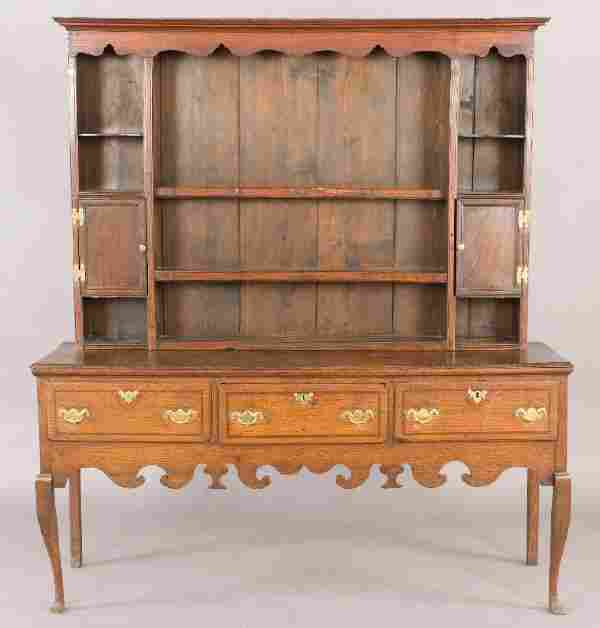 121: An English oak Welsh dresser in two parts having