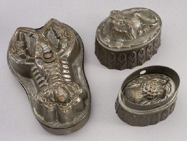 3: (3) Tin and copper jelly molds including