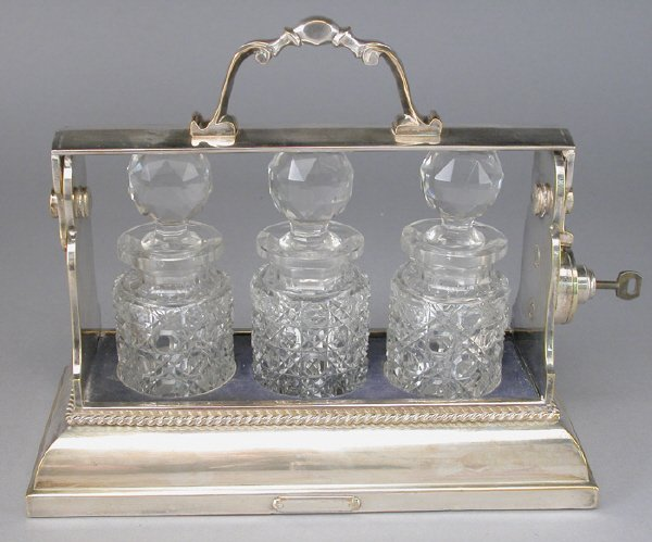4: A silver plate English tantalus having a