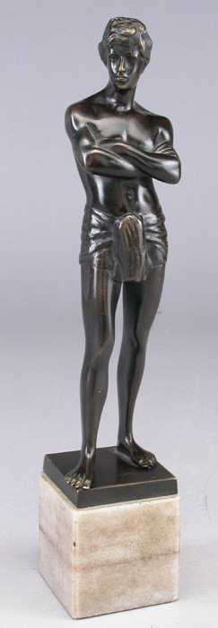 7: A bronze figure of a standing boy with arms
