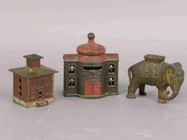2: 3 vintage cast iron banks. (1) cast iron still