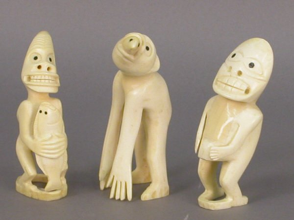 10B: Group of three interesting ivory figures from