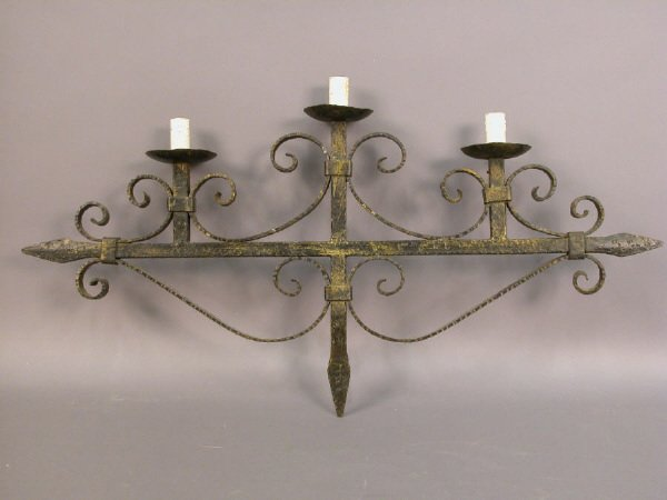 12: An Italian forged 3-light iron sconce.
