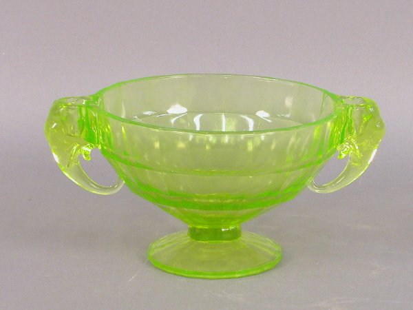13: A large Vaseline glass compote with two