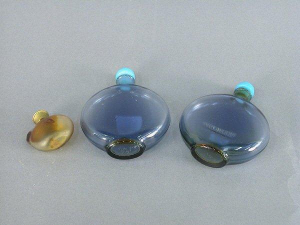 20B: (3) Marked Lalique perfume bottles. (2) marked