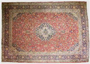 A semi-antique Kashan Oriental rug.