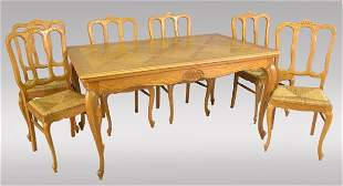 A 7pc. Country French style oak dining suite.