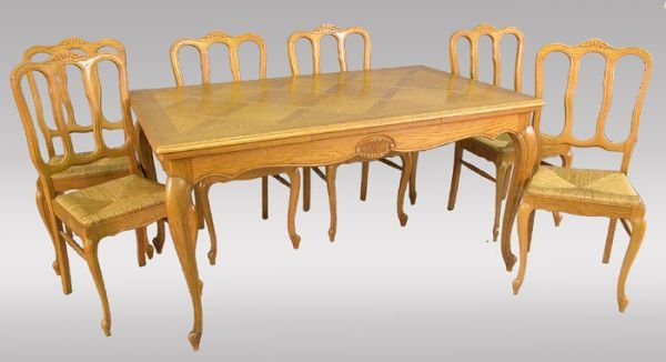 161: A 7pc. Country French style oak dining suite.