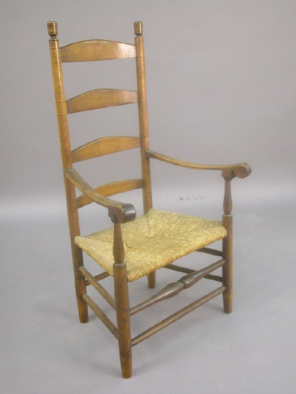 166: American ladder back armchair with rush