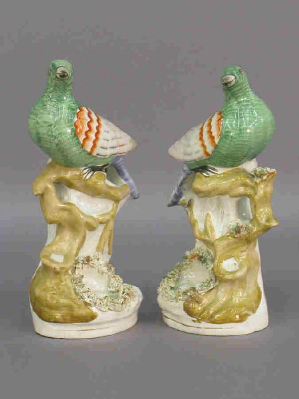 217: Pair of early Staffordshire pigeons perched on