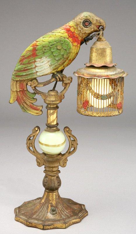 4: An Art Deco cast metal parrot lamp, the parrot,
