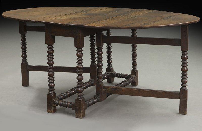 Large 18th C. English oak oval gateleg table