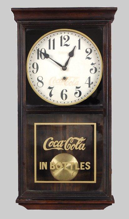 17: Coca-Cola Gilbert advertising regulator clock