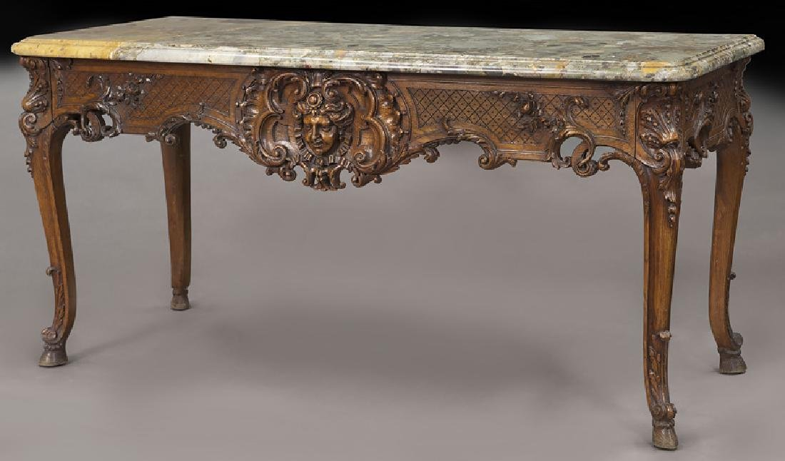 Carved console with Brèche d'Alep marble top,