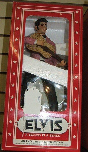 19: Elvis McCormick decanter in box pink coat