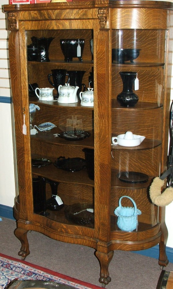 276: Oak Curved Glass China cabinet w/carved lions head