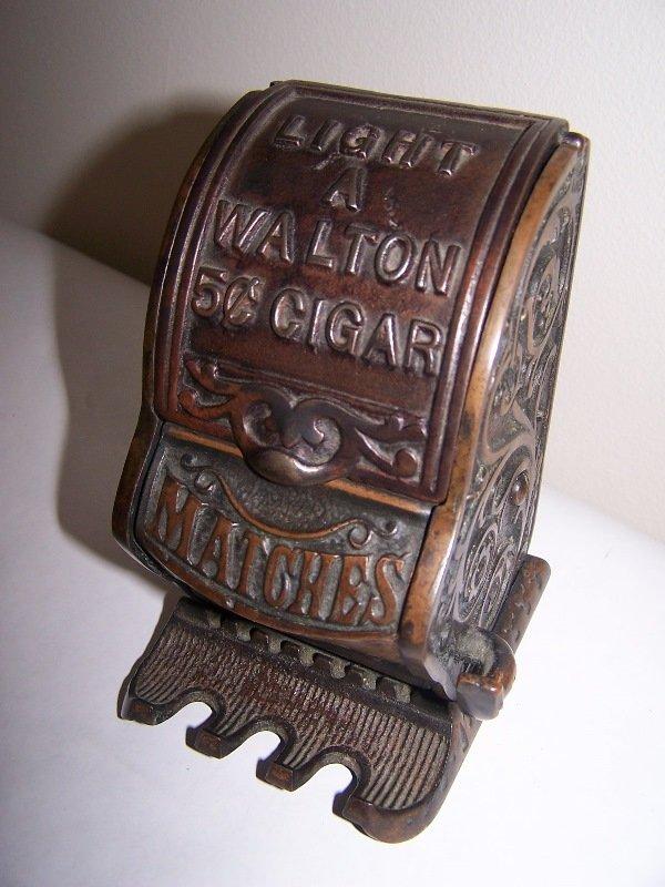 """1011: Match dispenser; cast iron;5""""T x3 3/4""""d x3 1/2"""" w"""