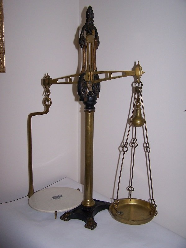 1012:  Scale iron and brass balance scale; marked on wh