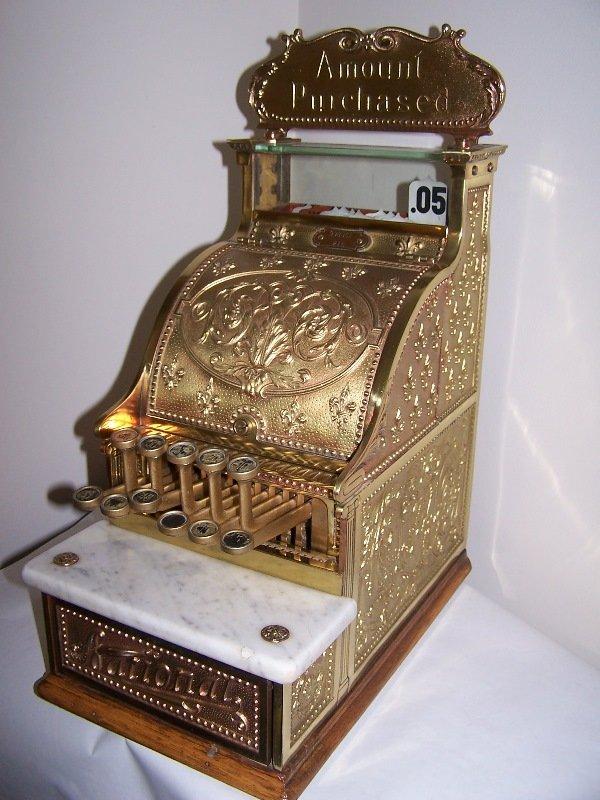 1016: Cash register ; National $1 ; restored brass with