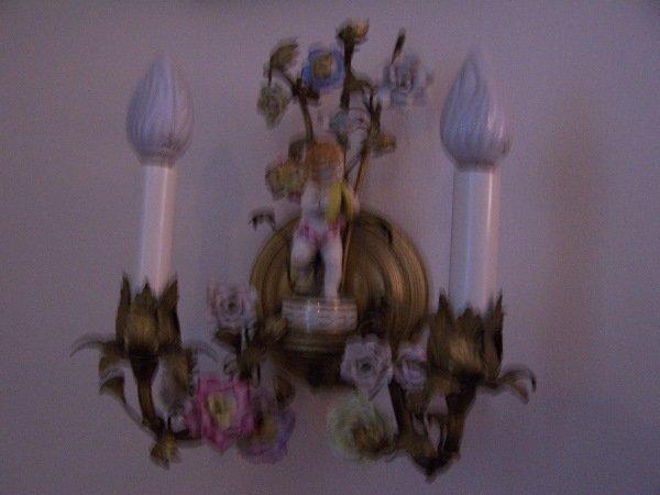 1022: Wall sconce; brass w/ porcelain flowers & child c