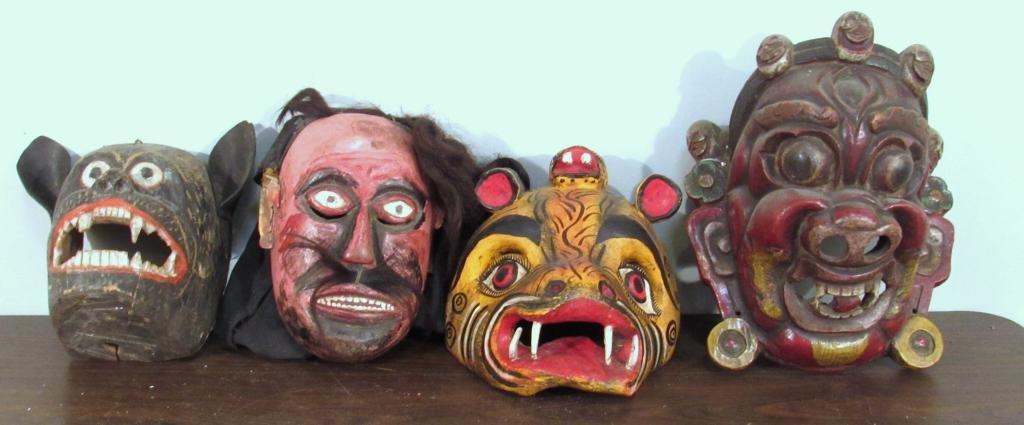 4 Large Carved Wood Indonesian Masks