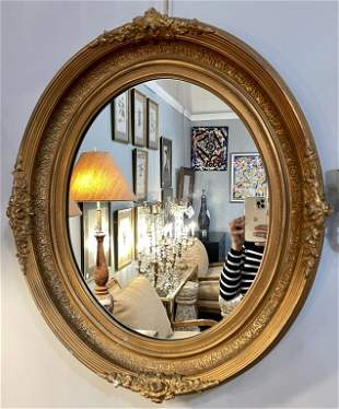 Oval Gilt Wood Mirror.
