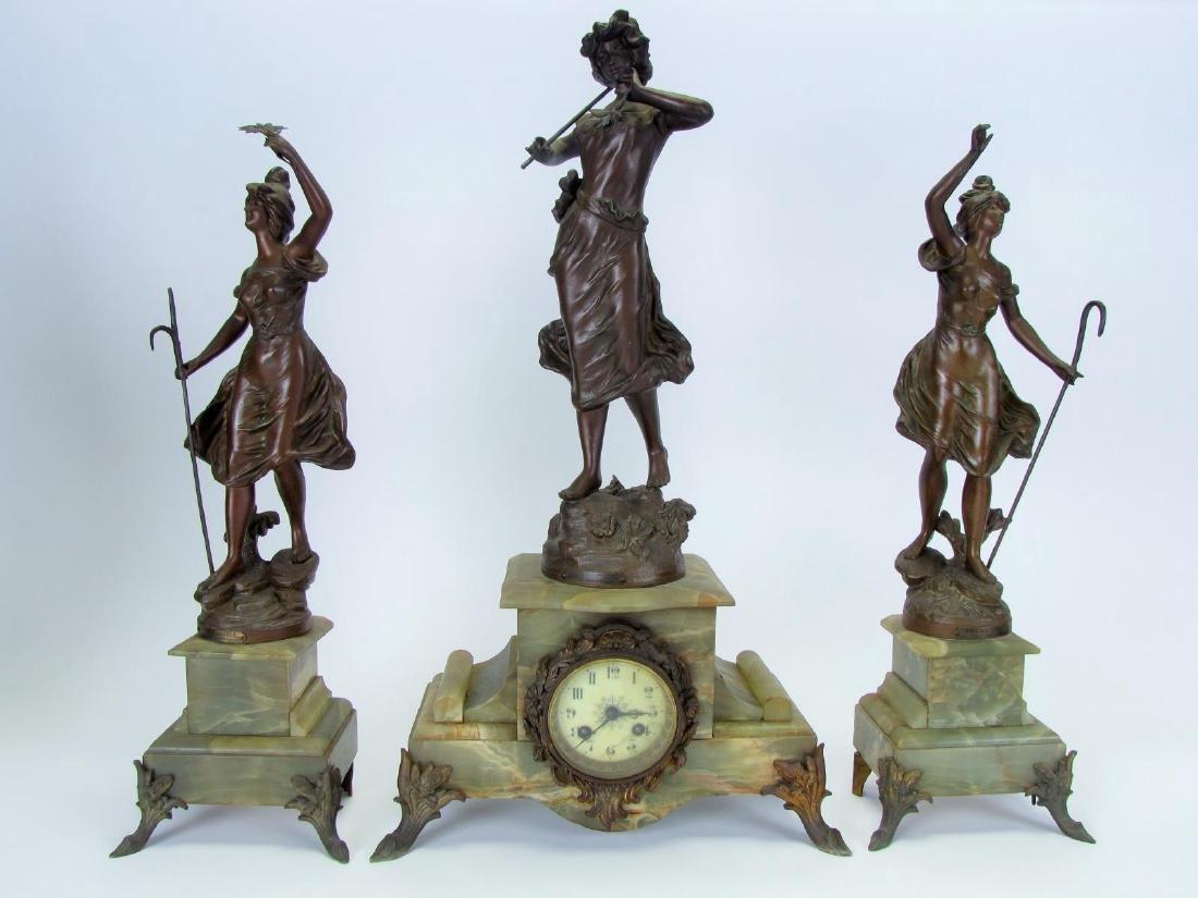 Figural Spelter Clock and Garniture Set