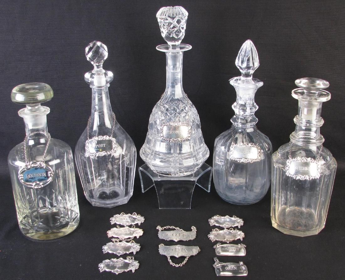 Five Glass Decanters with Badges